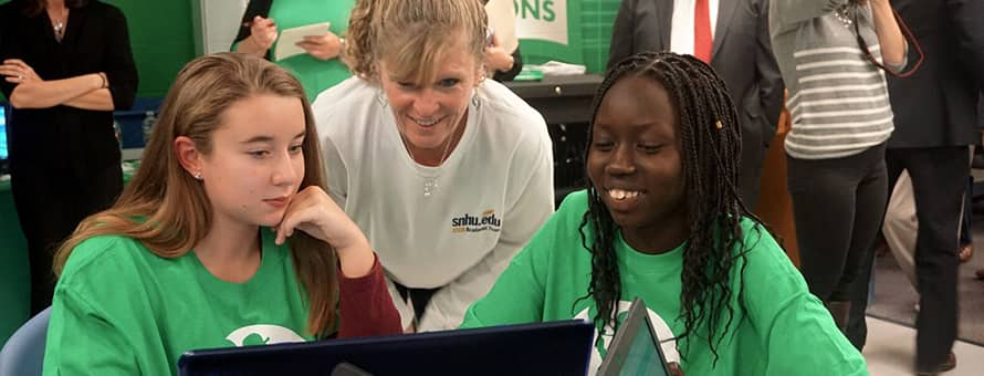 Dr. Gwen Britton helping two Parkside students with a coding exercise