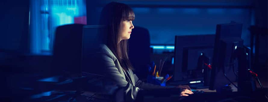 ​Woman sitting at desk working to improve her cyber security skills​