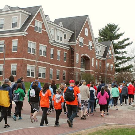 A large group of people on SNHU's campus participating in a Global Days of Service project.