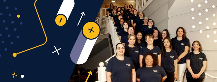 The women from SNHU who attended the 2019 Grace Hopper Celebration lined up on a staircase.
