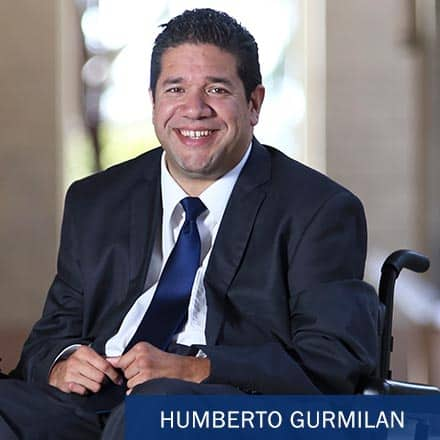 Humberto Gurmilan sitting in his wheelchair and the text Humberto Gurmilan.