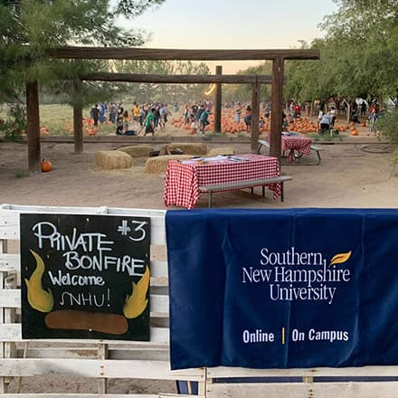 An SNHU blanket on a fence at a Phoenix pumpkin patch where an alumni event was held.