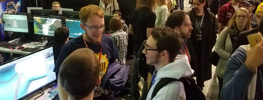 SNHU students vitising a booth at PAX East