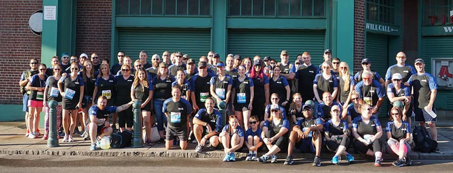 Group of Run to Home Base participants from SNHU outside Fenway Park