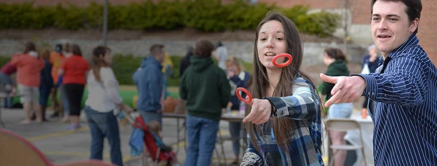 Students playing a ring toss game
