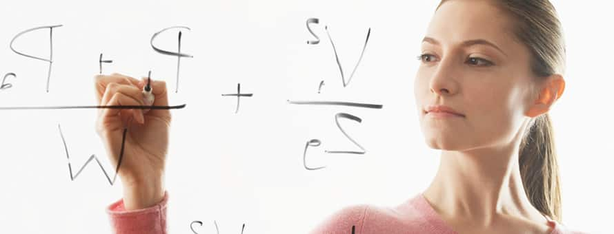 Woman working out math problems