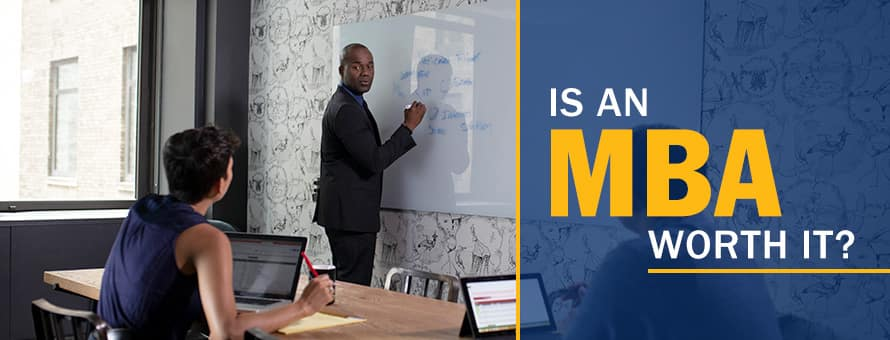 A man standing at a white board explaining what an MBA is to a person on a laptop and the text 'Is an MBA Worth It?