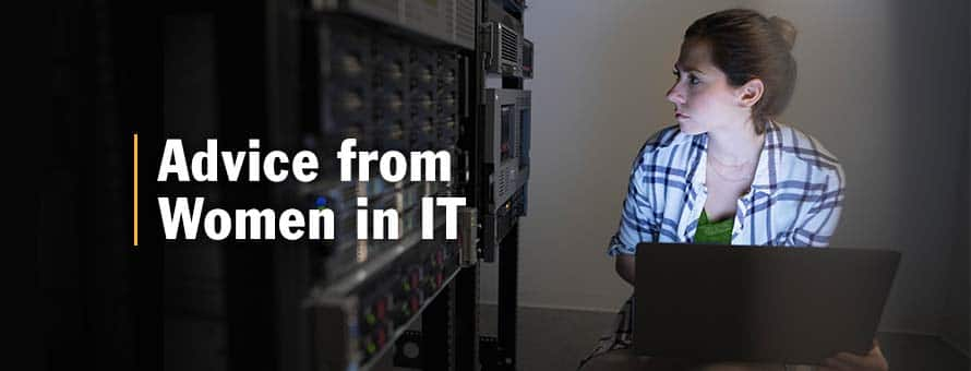 IT professional with a laptop inside a server room