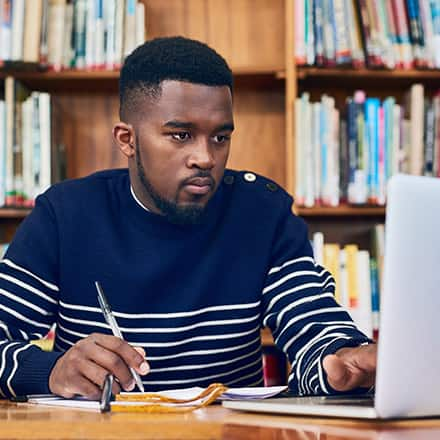An online learner studying on his laptop.