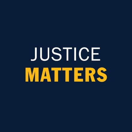 The text justice matters in white and yellow font.