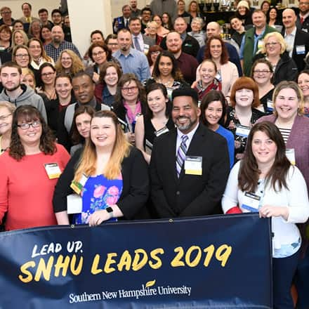 A large group of people at the 5th annual SNHU LEADS Conference at Southern New Hampshire University.