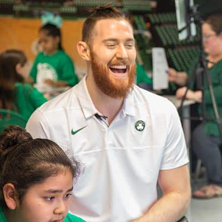 Celtics center Aron Baynes laughing while working with students of Fairgrounds Elementary