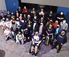 A group of snhu esports players at the grand opening of arena