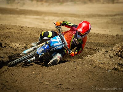Marissa Markelon going around a tight curve on her dirt bike during a race.