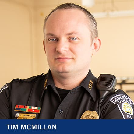 Tim McMillian in a police uniform with text: Tim McMillian