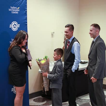 Jenny Barrezueta receiving flowers from her son