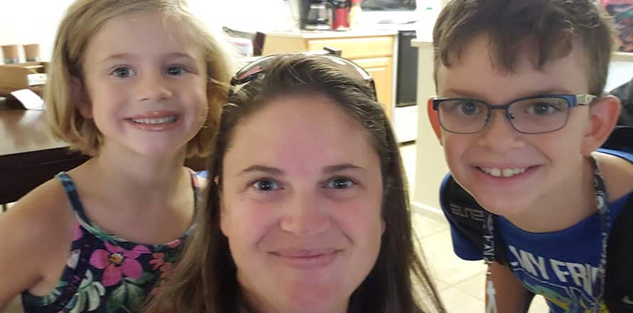 A selfie of Heather Poss and two of her kids in their kitchen