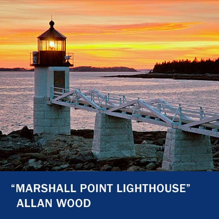 """A white lighthouse off a dock with a sunset in the background with the text """"Marshall Point Lighthouse"""" Allan Wood"""