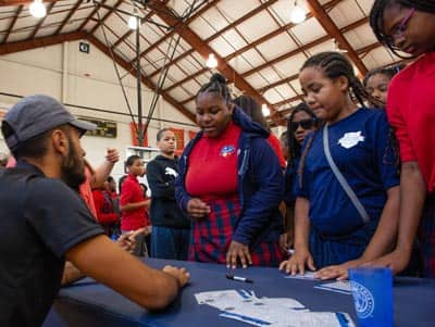 Photo of students meeting and getting an autograph from Philadelphia Union player Matt Real.
