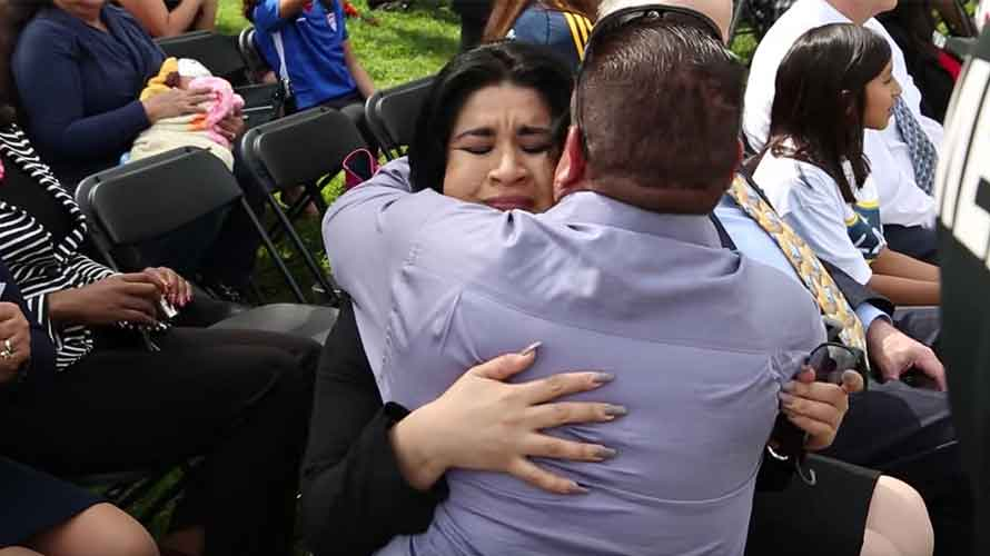 Veronica Rodriguez hugging her father