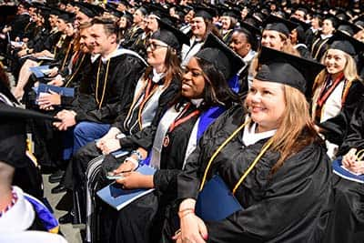 Crowd of SNHU graduates sitting at the 2019 ceremony