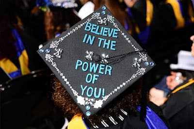 "Graduation cap designed to say, ""Believe in the Power of You"""