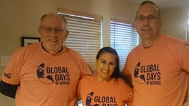 "Three SNHU community members posing together in shirts that have the text ""Global Days of Service"""