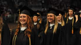 A group of students smiling at commencement