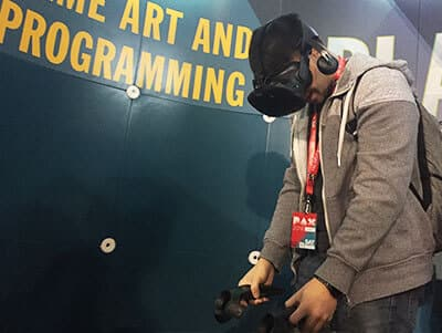 Person playing on the Vive, virtual reality headset.