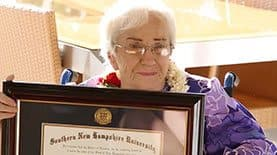 Amy Craton holding her SNHU diploma