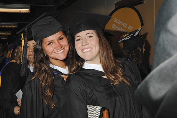 Two Students at Commencement 2014