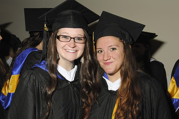 Two Students Celebrating Commencement 2014