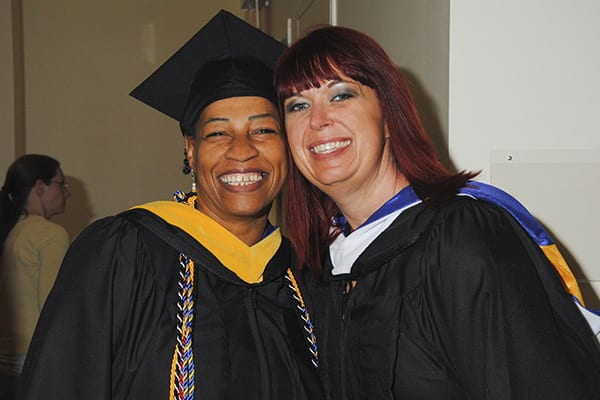Two happy students at Commencement 2014