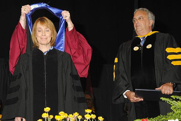 Maggie Hassen receiving a sash at Commencement 2014