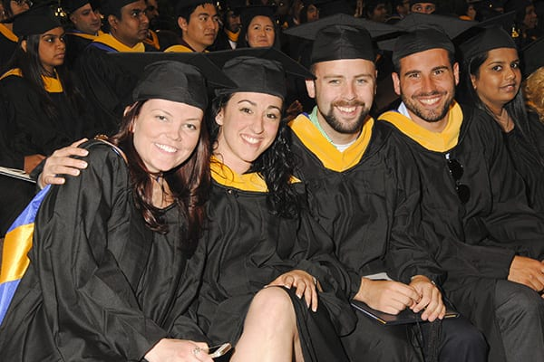 a group of students sitting at Commencement 2014