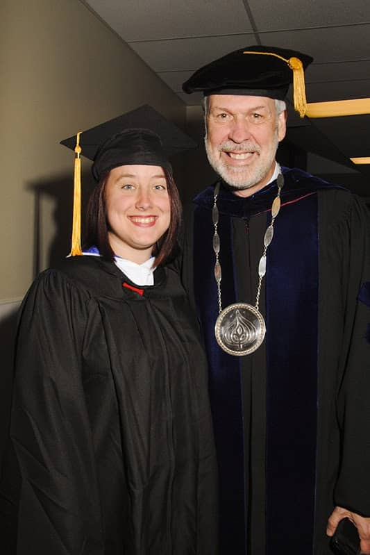 A student and SNHU president Paul LeBlanc at Commencement 2014