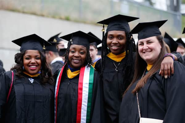 Four students at commencement 2015