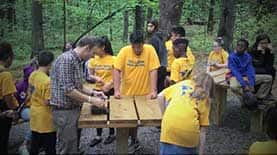 ​Mike Weinstein and a group of McLaughlin Middle School students in the Arboretum's outdoor classroom​