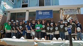Group photo of those who volunteered to help build a home