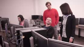 Students and instructors in a computer lab