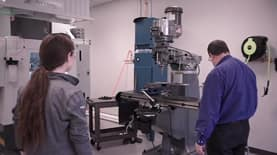 Student and instructor in a SNHU mechanical engineering classroom
