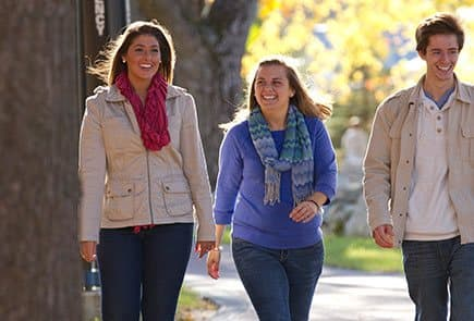 Three potential campus students tour the SNHU campus during an admission event.