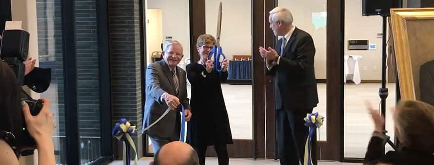 ​Dr. Richard A. Gustafson​ and his wife cutting the ribbon for the Gustafson Center grand opening​
