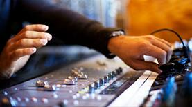 Audio engineer working with a sound board