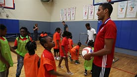 MLS players teaching kids about soccer