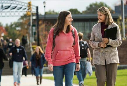 A student and her professor walking through campus